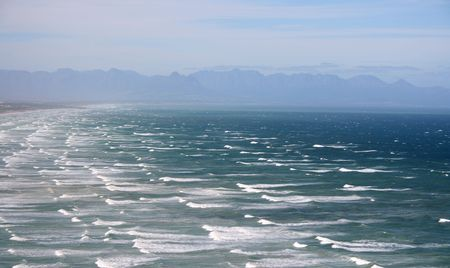 Ocean view on a windy day with restless waters