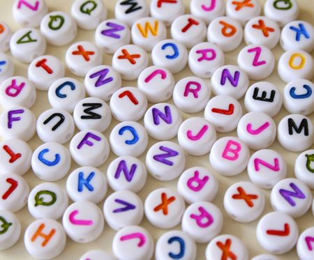 Small Colorful letters on different white shapes photo