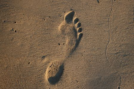 Human footprint in the sand on the beach Stock Photo