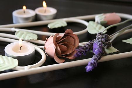 Wrought Iron flower patterns with fresh flowers and candles photo