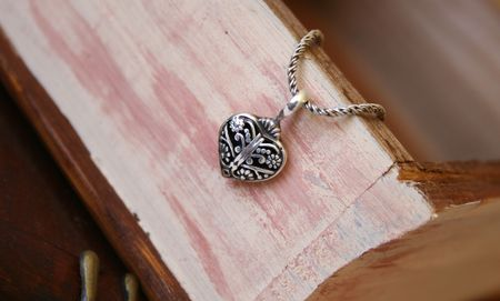 jewellery box: Silver Heart Jewellery on a woonden jewellery box Stock Photo