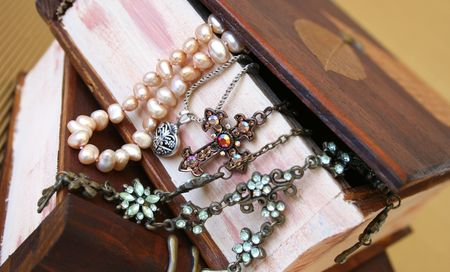 jewellery box: Assortment of jewellery haning from a wooden jewellery box Stock Photo