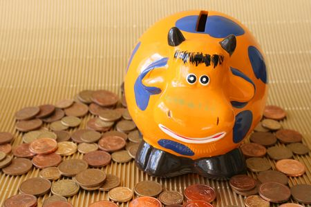 coppers: Money box in the shape of an orange cow