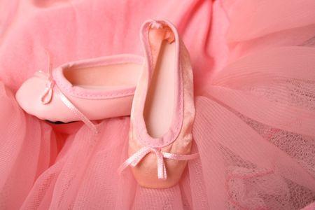 Pink Ballet costume and miniature ballet shoes Archivio Fotografico
