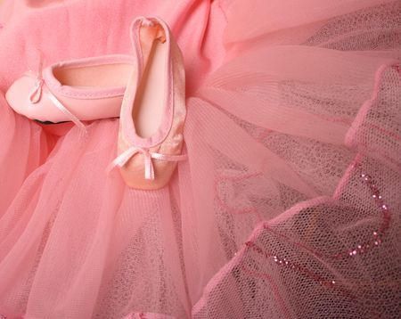 tutu: Pink Ballet costume and miniature shoes with bows Stock Photo