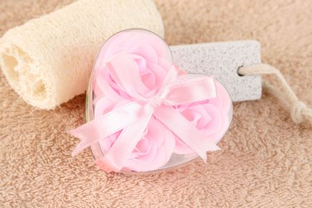 shaped: Pink Flower soaps in a heart shaped container Stock Photo