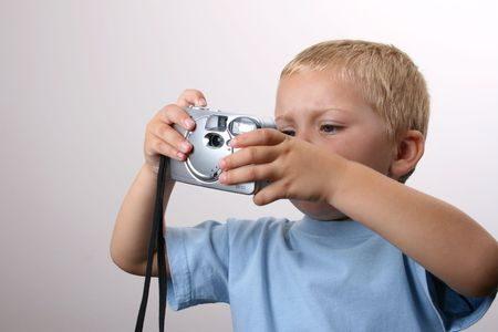 teary: Beuatiful Blond toddler with camera