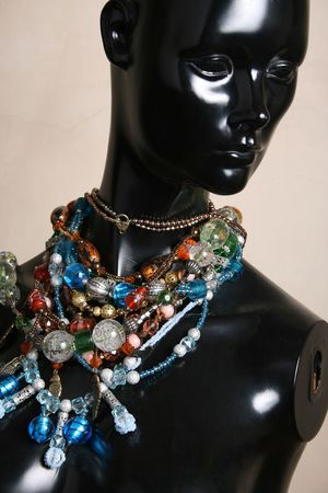 manequin: Black Jewelery stand with bulky beaded strings