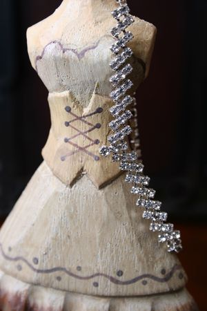 Wooden Jewelery stand with diamond necklace hanging