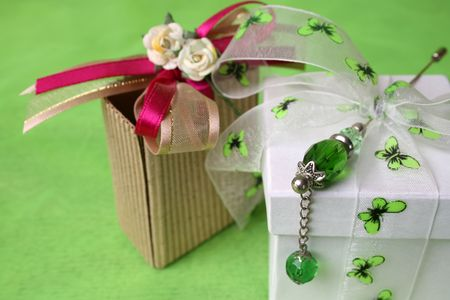 White gift box and small brown gift bag photo