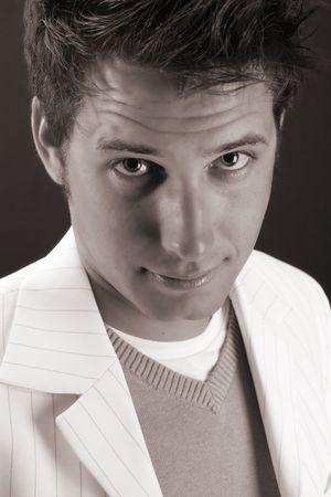 Male model in studio against black background photo