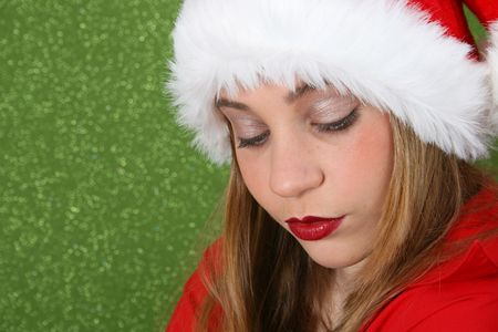 Christmas teen wearing a red hat, looking dissapointed Stock Photo - 3435266