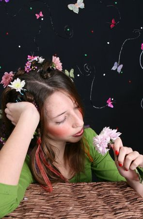 bore: Teenage model with flowers and butterflies in her hair