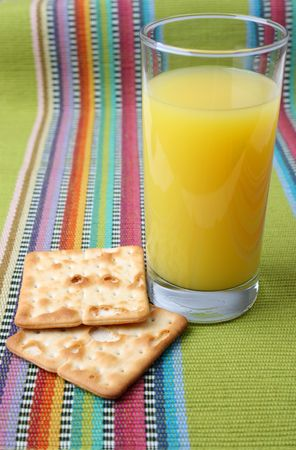 quencher: Glass of Orange Juice and two crackers
