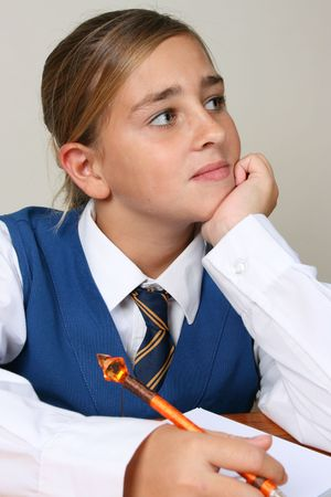 Teenage School girl busy with her homework, wearing uniform Stock Photo - 3583375