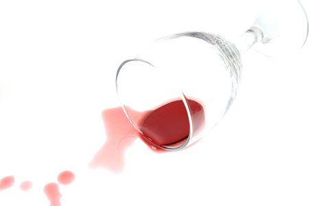 knocked over: Knocked over wine glass with red wine spill Stock Photo