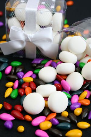 PVC Box decorated with ribbons, containing sweets photo