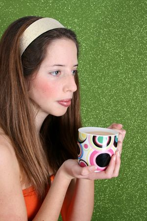 Brunette teenager on a green background wearing a broad head band Stock Photo - 3679018