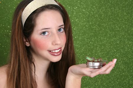 Brunette teenager on a green background wearing a broad head band photo