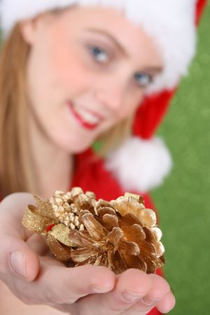 Teenager with red lips presenting Christmas Decorations. FOCUS on decorations