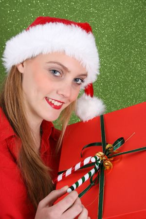 Christmas girl holding a red gift box with decorations Stock Photo - 3782326