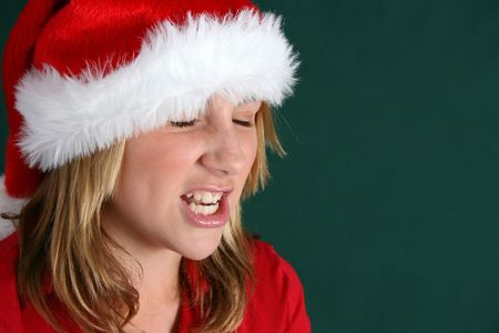 Annoyed teenager expressing her feelings about christmas