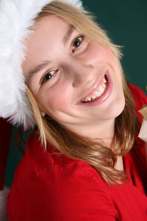 Christmas teen wearing a red hat with a big smile Stock Photo