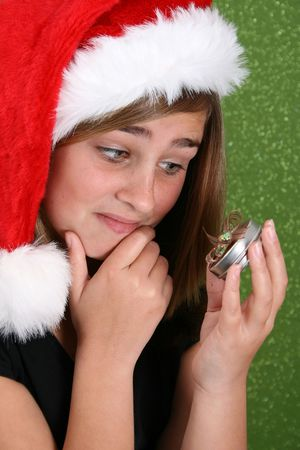 tussle: Teenager with red lips wearing a christmas hat