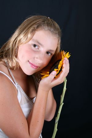 Teenage female model on a black background photo