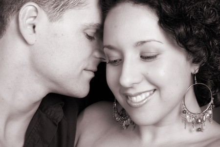 Young couple in love, faces close to one another Stock Photo