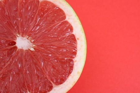 Half Sliced Pomelo on a bright background