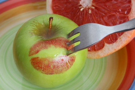 Sliced Pomelo and a whole apple with red lips Banco de Imagens