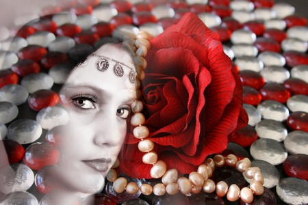red pebble: Female model withwearing folk dress layered with pebbles and jewelery