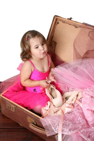 Little girl with short hair wearing a bright pink ballet outfit