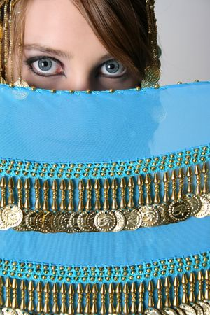bellydancing: Beautiful young teenager posing in a belly dance costume