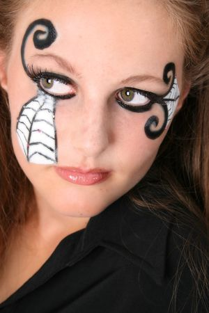 Close-up of Halloween teenager with face paint photo