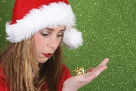 dissapointed: Teenager with red lips wearing a christmas hat