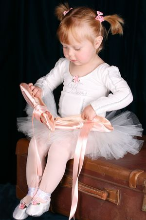 Little ballet toddler wearing a white tutu