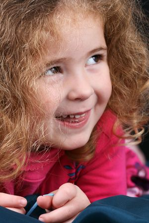 Beautiful young girl with curly hair and cute features Stock Photo - 6309721