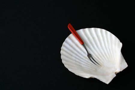 Fancy shell shaped dish with fork for starters Stock fotó