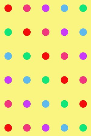 kiddies: Various coloured dots on a yellow background Stock Photo