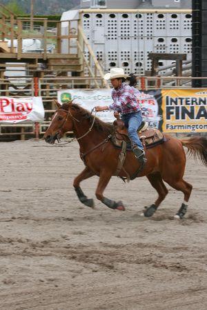 MERRITT, B.C. CANADA - MAY 22: Cowgirl barrel racing event at Richest Indian Rodeo May 22, 2010 in Merritt British Columbia, Canada