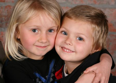Beautiful young girl with blond hair and her cute boy friend  Stock Photo - 7057144