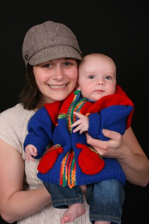 Beautiful mother and baby on a black background photo