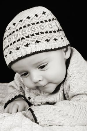 lying on his tummy: Cute four month old baby boy lying on his tummy Stock Photo