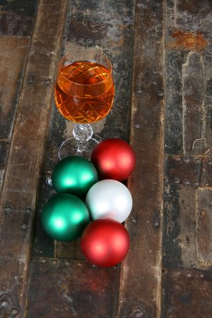 One crystal glass with christmas decorations on a wooden chest Stock Photo - 7424694