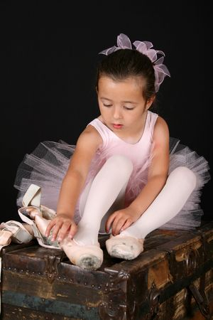 pointes: Cute little ballet girl trying on pointe shoes