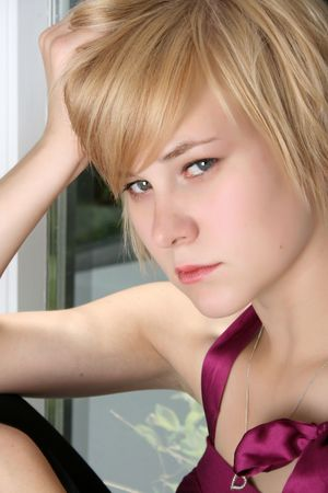 innocent girl: Beautiful blond female with a sad expression on her face Stock Photo