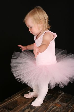 Cute little blond girl wearing a tutu and one ballet shoe Stock Photo - 7802060