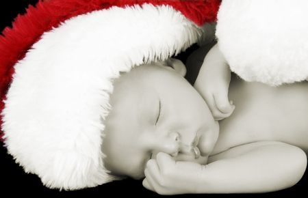 Beautiful Newborn christmas baby wearing a fluffy hat photo